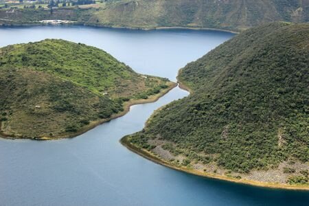 Green plants on the two islands in the volcanic crater lake Lake Cuicocha near Cotacachi Ecuador
