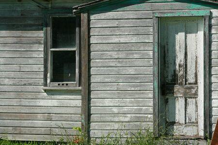 An old wooden farmhouse on a farm in Altona Manitoba Canada