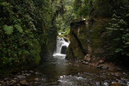 A waterfall on a river in Mindo Ecuador Фото со стока