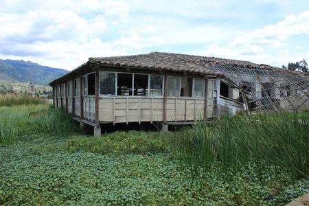 pablo: A wood building in a marsh on Lake San Pablo near Otavalo, Ecuador Stock Photo