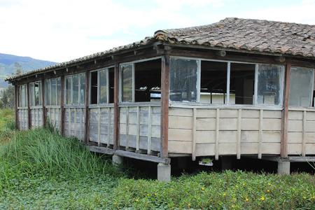 A wood building in a marsh on Lake San Pablo near Otavalo, Ecuador Фото со стока