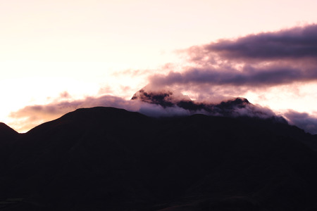 dormant: Sunset on the dormant volcano Mount Cotacachi in the Andes Mountains near Cotacachi Ecuador Stock Photo