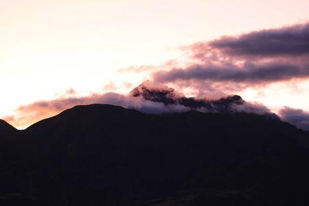 Sunset on the dormant volcano Mount Cotacachi in the Andes Mountains near Cotacachi Ecuador Фото со стока