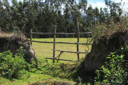 A wood rail fence in a pasture on a farm in Cotacachi Ecuador
