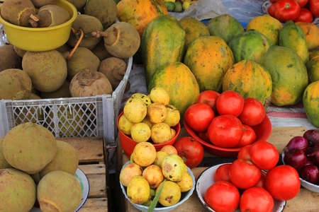 Exotic fruits and vegetables for sale at the outdoor food market in Otavalo, Ecuador