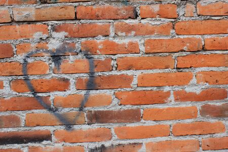 A heart painted on a brick wall in Cotacachi, Ecuador