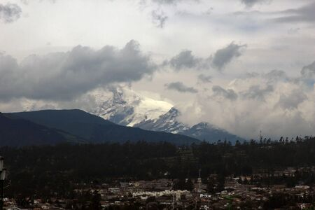 The snow covered summit of the volcano, Mount Cayambe, in the Andes Mountains in Northern Ecuador Фото со стока
