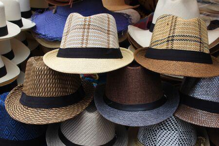 Colorful handmade hats at the outdoor craft market in Otavalo, Ecuador Фото со стока