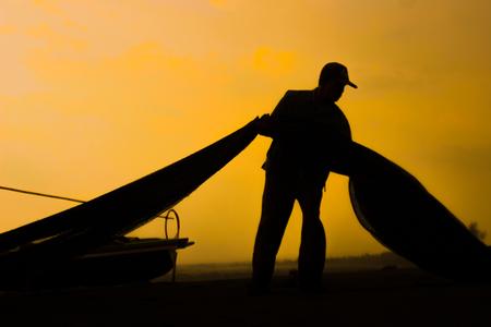 siluet of fisherman indonesia