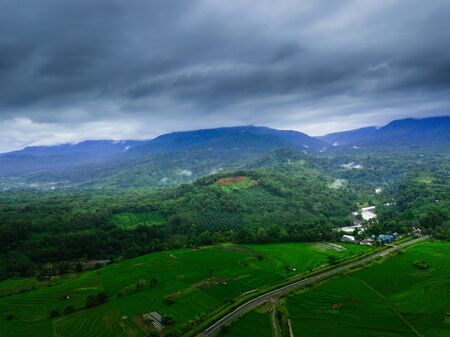 Indonesias natural beauty of Sumatra, where green rice fields with high mountains and beautiful blue clouds for a relaxing trip beauty morning