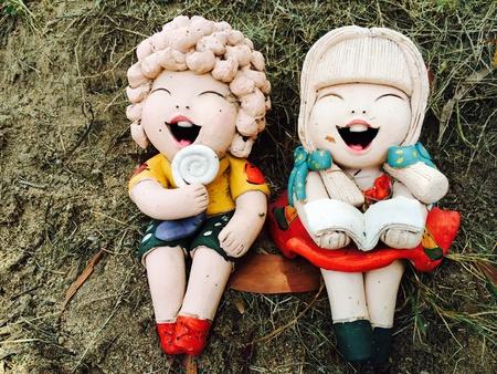doll: smiling doll in garden