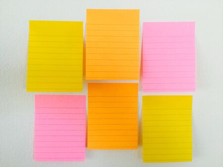 notepaper: Note paper color on the wall post background Stock Photo