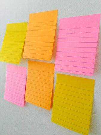 note paper: Note paper color on the wall post background Stock Photo