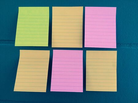Note paper color on the wall post background Stock Photo