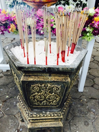 sacrifices: Incense burn and smoke