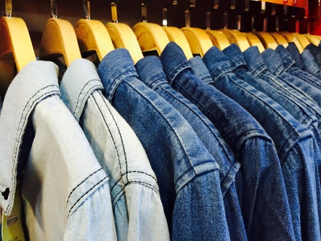 denim jeans: Jacket jeans hanging in cloth shop Stock Photo
