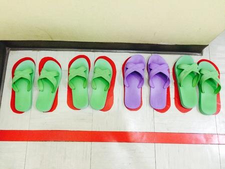 wearing sandals: slipper, carpet slippers