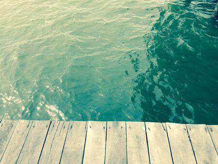 extending: Wood floors extending to the sea