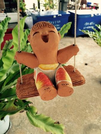 statuary garden: Teddy boys play crib Stock Photo