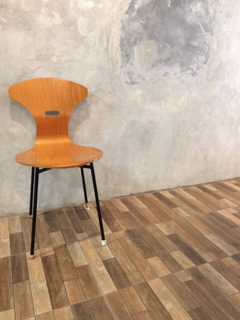 modern: modern chair against modern wall background