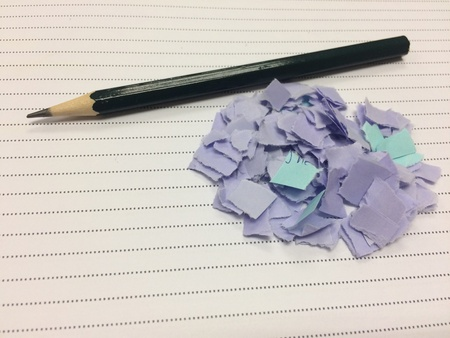 pencil and paper fragments from the work on the notebook has space for whiting Stock Photo