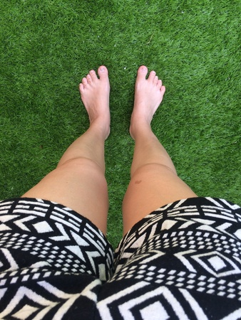 A foot on the green grass