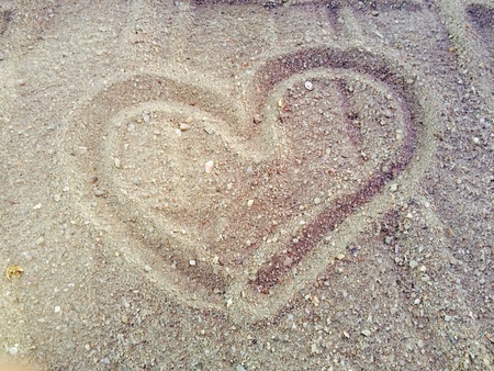 Draw heart on the sand is symbol of love Stock Photo