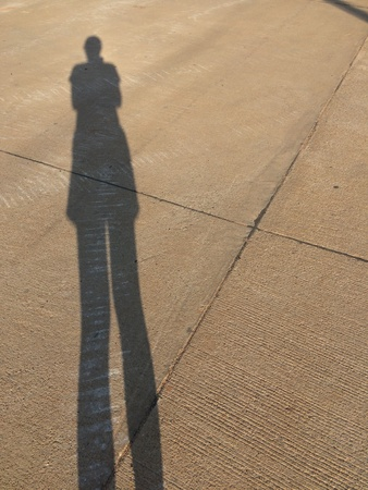 the shadow of a woman on the floor of the corridor Stock Photo