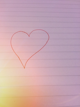 Draw a heart on the book to show love