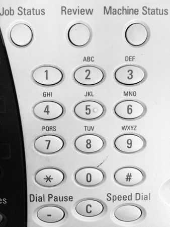 back: Black and white image of the control button