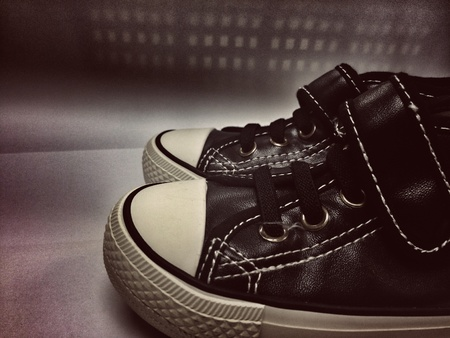style: vintage or old sneaker , travel and freedom concept