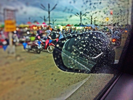 style: Rain drops on the windshield, the rainy season in which the car was taken away Stock Photo