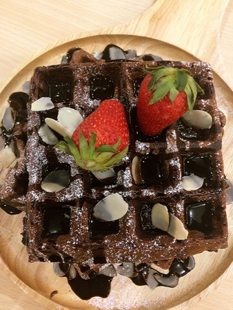 Honey toast with chocolate sauce and strawberry topping