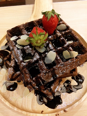 style: Honey toast with chocolate sauce and strawberry topping