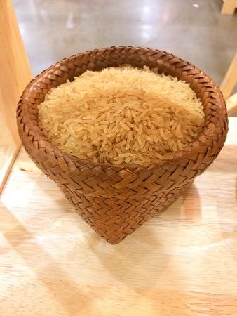 closeup: raw rice in wood basket, Thailand rice Stock Photo