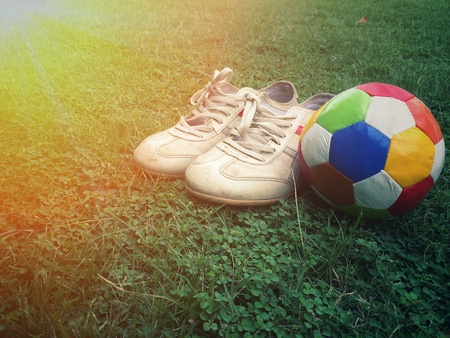 black: football and sport shoes on field
