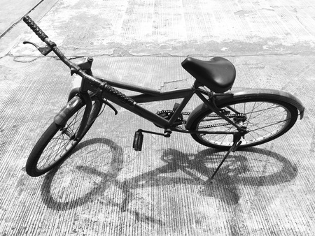 style: Old bicycle parked under the sun