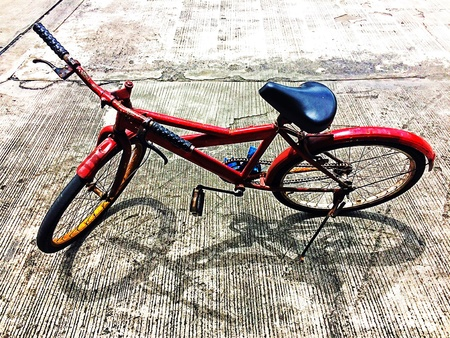 style: Old bicycle parked under sun