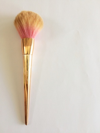 Makeup brush on a white background