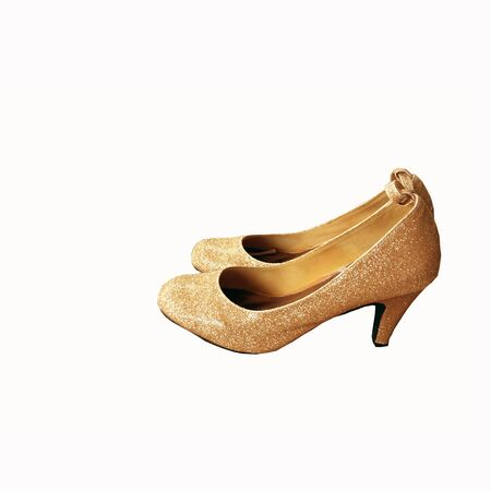Gold shoes coated with diamonds isoleted on white background and have clipping paths for design in your work