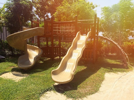 The playground has a large slider on sunshine day Stock Photo