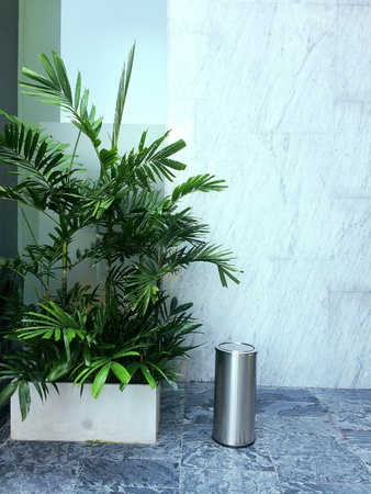 The smoking corner in the building provides ashtrays and trees Stock Photo
