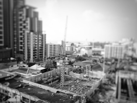 Blurry black and white picture of resident construction because increase people in the city and growth business concept