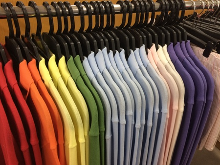 row of working shirt hanging orderly on cloth shop