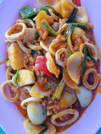Stir Fried squid with salted egg york in night dining resturant