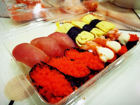 close up Sushi and sashimi buffet in night dining restaurant