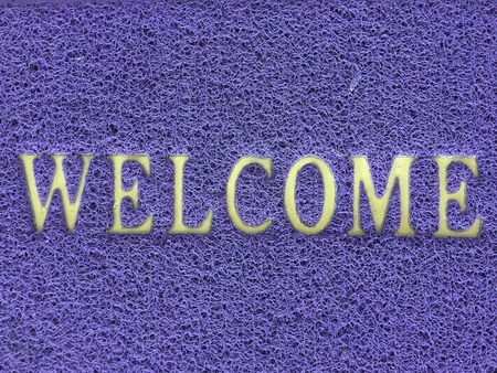 welcome alphabet in violet color texture pattern background