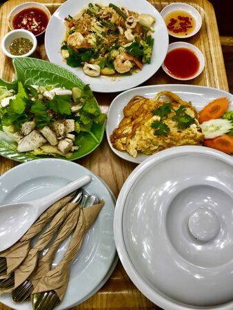 Table full with Thai food