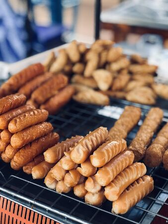 close up fried meat sell in street food market ,cuisine and food travel concept