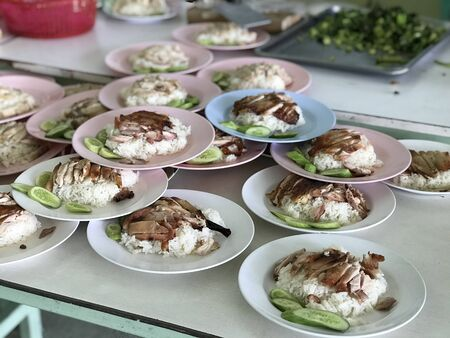 close up arrang for serve of Hainanese chicken rice, grill chicken and white rice 写真素材